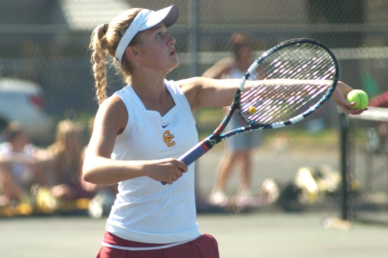 by: PAMPLIN MEDIA GROUP: DAVID BALL - Central Catholic's Elizabeth Johnson prepares to put a serve in play during her 6-4, 7-6 win over Gresham's Jessica Emoto in Wednesday's district singles final.
