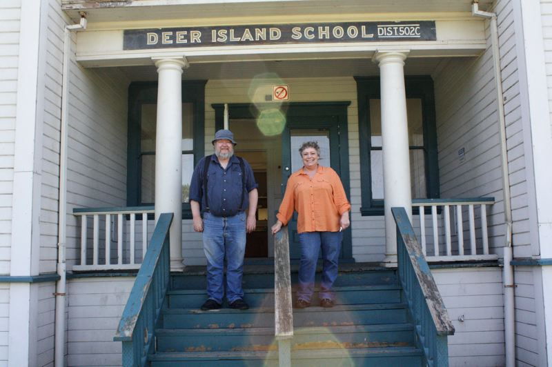 by: SPOTLIGHT PHOTO: KATIE WILSON - Jay and Deborah Meritt stand in front of the Deer Island school. Both retired, they plan to turn the school into a restaurant and pub while still retaining the buildings historic features.