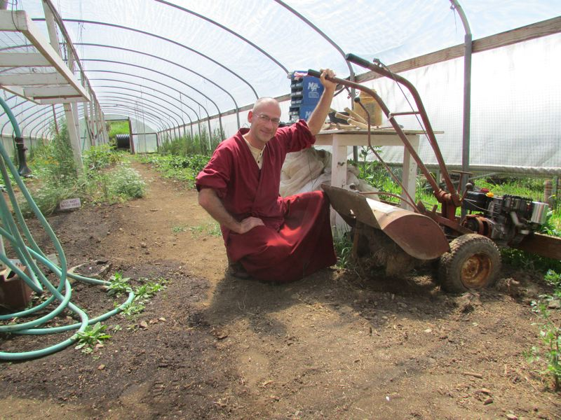 by: SPOTLIGHT PHOTO: ROBIN JOHNSON - Lodru, A Tibetan Monk Studying at Great Vow Zen Monastery maintains the centers farming and gardening equipment. Prospective Buddhists can apply for a free meditation and organic gardening program through July and August.