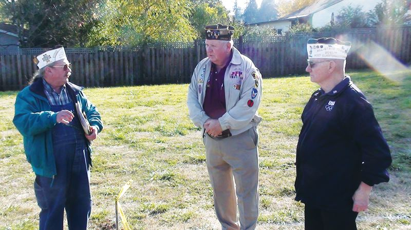 by: DARRYL SWAN - Local VFW representatives (from left) Ron Urban, Frank Weber and Jerry Peal last October consider the site of a new U.S. Amed Forces Memorial in Scappoose. Next Saturday, May 18, VFW representatives are hosting a dedication ceremony for the new memorial.