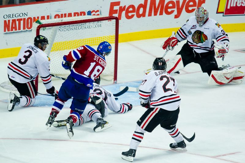 by: TRIBUNE PHOTO: CHRISTOPHER ONSTOTT - Michael St. Croix of the Edmonton Oil Kings fires a shot past the scattered Portland Winterhawks defense, with goalie Mac Carruth (right) trying in vain to get back to the net. The score gave Edmonton a 2-1 lead in Game 5 of the Western Hockey League finals.