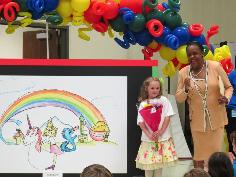 by: HILLSBORO TRIBUNE PHOTOS: KATHY FULLER - Hillsboro first-grader Maisie Davis won the state honor for the best Google doodle last week. She got to talk about it at her school.
