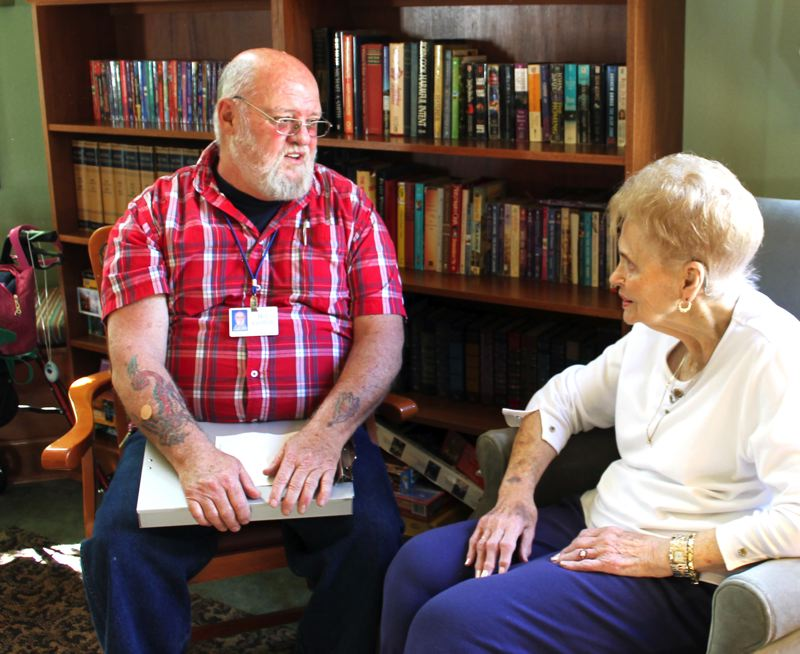 by: OUTLOOK PHOTO: CARI HACHMANN - Volunteer Ombudsman Bill Griffith checks in regularly with residents including Dorothy Oberg, who lives at Greshams Wynwood of Mt. Hood assisted living community.