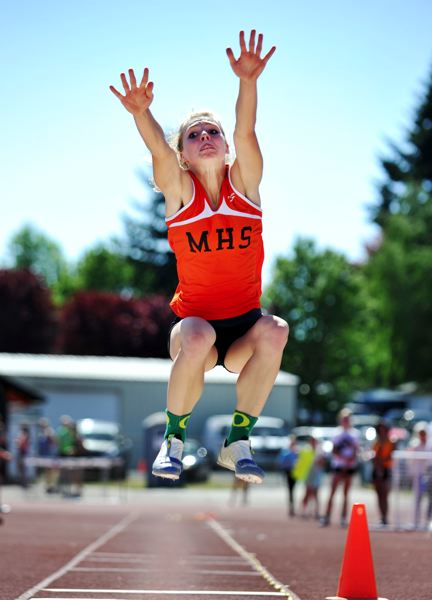 by: JOHN LARIVIERE - Molalla senior Claire Thomas leaped a states best 18-8 in the long jump at last weeks dual meet with Gladstone.