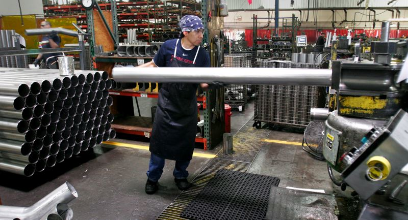by: OUTLOOK PHOTO: JIM CLARK - Tube Specialties Co. employee Angel Benitez loads a tube into a bender at the companys Troutdale facility.