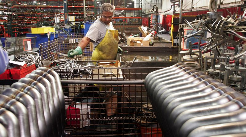 by: OUTLOOK PHOTO: JIM CLARK - Tube Specialties Co. employee Ben Reed tests the welds on products at the Troutdale facility.