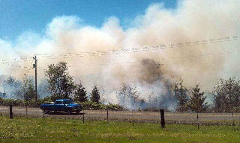 by: CONTRIBUTED PHOTO: CAROLE STAATZ - A small brush fire broke out on the 39000 block of Southeast George Road on the morning of Saturday, May 4.