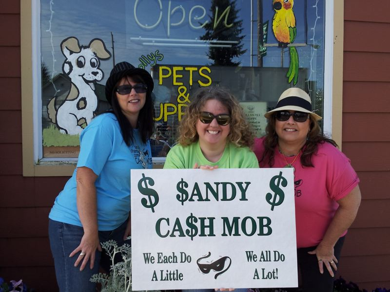 by: CONTRIBUTED PHOTO - Standing in front of Dolly's Pet Shoppe and trying to remain incognito are three mobbers, from left, Debbie Grimes, Lacy Renard and Foster.
