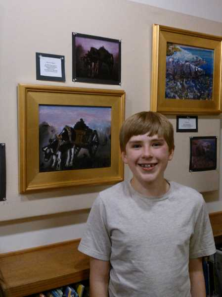 by: SUBMITTED PHOTO  - Nick Friesen, an art student at Studio 84 Fine Art School, stands by his first oil painting, a reproduction of Vincent Van Goghs Ox Cart.