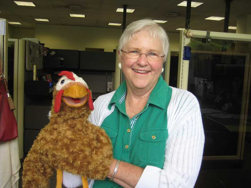by: SUBMITTED PHOTO - Lynne Bacon and Henrietta the Hen will keep you entertained at Luscher Farm with songs and stories all summer long.