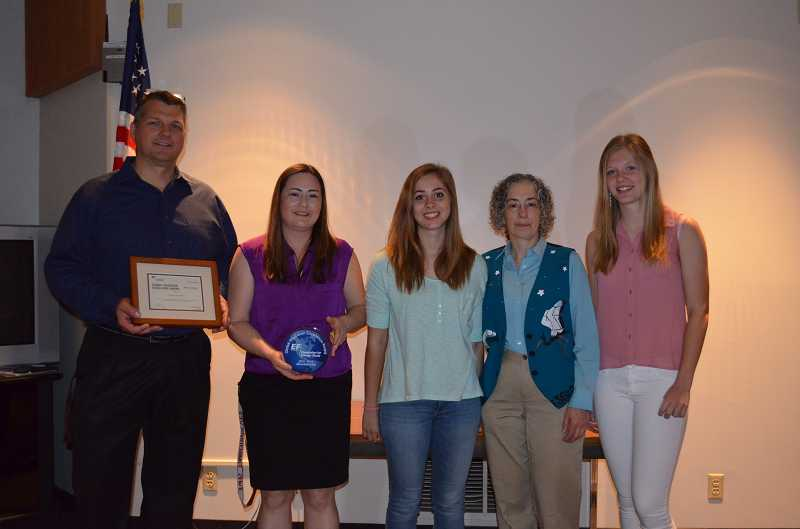 by: SUBMITTED PHOTO - Tualatin High School received the Education First Foundations Global Excellence Award last week. From left: Principal Darin Barnard, secretary Lisa Burton, EF Foundation student Matilde Guazzelli (from Italy), Laura Kosloff (EF Foundation International Exchange Coordinator), and EF Foundation student Sara Bjoerk (from Sweden).