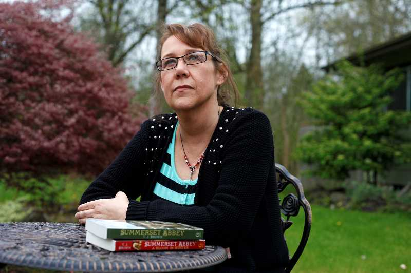 by: TIMES PHOTO: JONATHAN HOUSE - Tigard author Teri Browns next novel Born of Illusion will be released next month. Brown spent months editing the book, and writing three others, while undergoing treatment for throat cancer last year