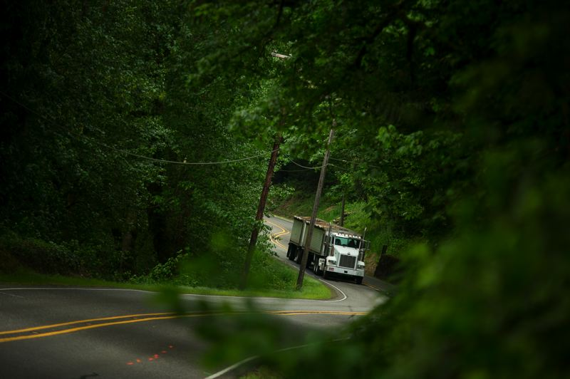 by: TRIBUNE PHOTO: CHRIS ONSTOTT  - Large trucks leave little room for error on Multnomah Countys narrow and twisty portion of Northwest Cornelius Pass Road.