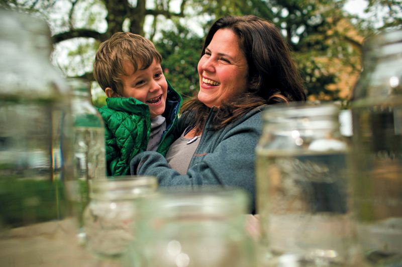 by: TRIBUNE PHOTO: CHRISTOPHER ONSTOTT - Anti-lead activist Tamara Rubin, of the Lead Safe America Foundation, at home with her son Charlie, 4. Rubin is against fluoride in the water, stating that it increased the chances of ingesting lead from the water supply.