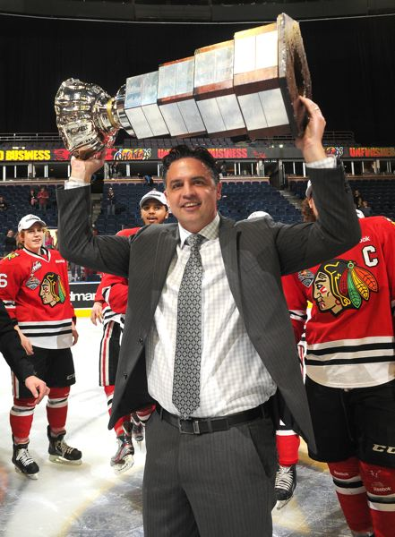 by: COURTESY OF PORTLAND WINTERHAWKS - Coach Travis Green hoists the Ed Chynoweth Cup after the Winterhawks won the Western Hockey League title last Sunday at Edmonton.