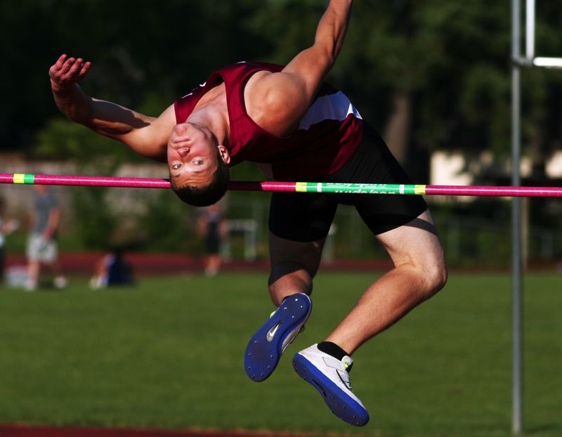 by: PAMPLIN MEDIA GROUP: AMANDA MILES - OVER THE BAR -- Tualatin's Ryan Wisner cleared 6 feet, 5 inches in the high jump competition during last week's meet at Century.