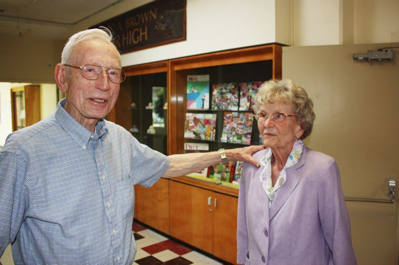 by: HILLSBORO TRIBUNE PHOTO: DOUG BURKHARDT - In the hallway outside the schools gymnasium, former school teachers Burton and Margaret Huggett reminisce about Brown Middle School 50 years ago, when the school was brand new and called East Hillsboro Junior High. Margaret taught at the school for 23 years and her husband Burton was a substitute teacher there.