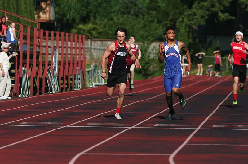 by: HILLSBORO TRIBUNE PHOTO: AMANDA MILES - Hilhi's Cricket Browning (51.51 seconds) and Glencoe's Ryan England (51.64) race to a 1-2 finish in the boys 400 meters last Wednesday.