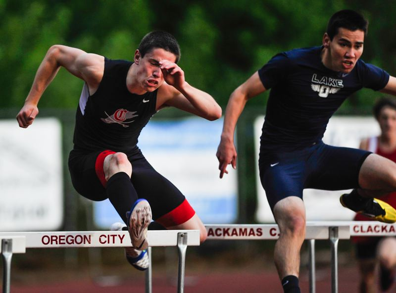 by: JOHN LARIVIERE - Two of the states top hurdlers, Clackamas junior Connor McLean (left) and Lake Oswego junior Connor Bracken, battle in the finals of the intermediate hurdles at last weeks Three Rivers League District Meet. Bracken got the best of McLean in the high hurdles, but McLean ruled in the intermediates.