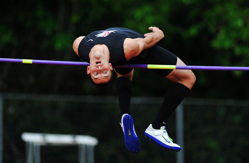 by: JOHN LARIVIERE - Clackamas senior Max Jette competes in the high jump in Fridays finals of the 2013 Three Rivers League District Track and Field Championships.