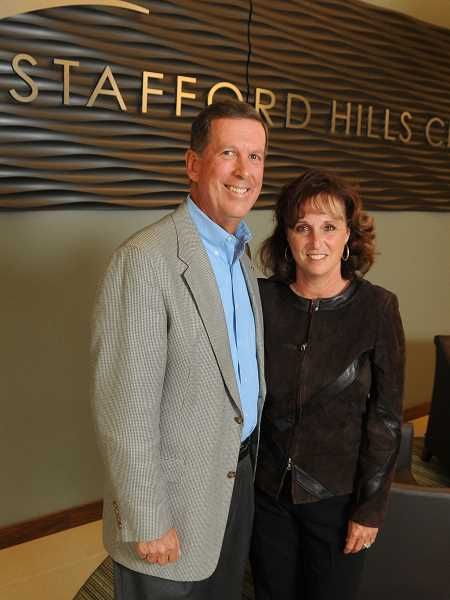 by: VERN UYETAKE - Jim and Marla Zupancic stand in the main lobby of the Stafford Hills Club, a relatively new private tennis, aquatic and health facility in Tualatin.