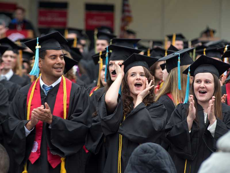 by: NEWS-TIMES PHOTO: CHASE ALLGOOD - Graduates celebrate their day as their time at Pacific University in Forest Grove comes to a close.