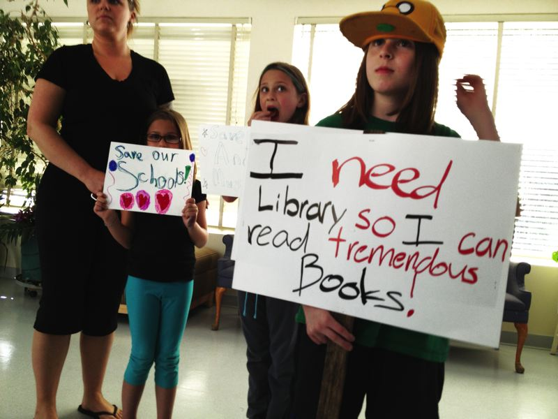 by: PHOTO CONTRIBUTED BY SANDY RICHARDS - Students from Clackamas River Elementary ask the state legislators to Save Our Schools at a Town Hall meeting on May 14.