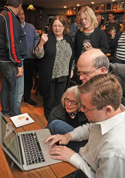 by: VERN UYETAKE - School board candidate Sarah Howell, back right, talks to Deborah Lopardo while additional campaign supporters including, from left, Audrey Mattison, former Mayor Jack Hoffman and Ben Patinkin check election results Tuesday night.