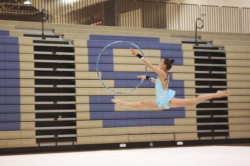 by: SUBMITTED PHOTO - Liani Li practices rhythmic gymnastics competitively. The sport combines elements of ballet and floor gymnastics.