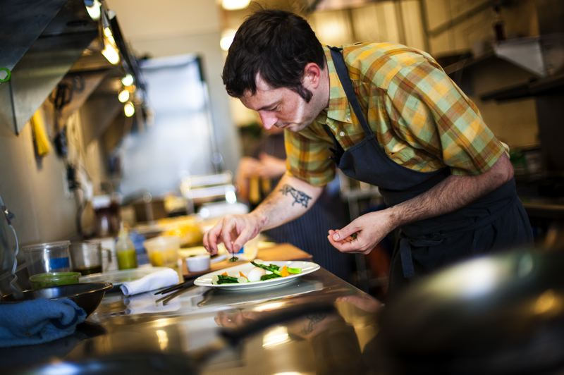 by: TRIBUNE PHOTO: CHRISTOPHER ONSTOTT - New chef Jake Martin has enhanced Genoas menu, which includes a salmon crudo dish. Genoa opened in 1971, but went through an ownership change in 2010.