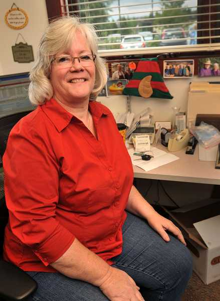 by: TIDINGS PHOTO: VERN UYETAKE - A part-time coordinator will take Lynn DePretto's place at her desk when she retires at the end of June.