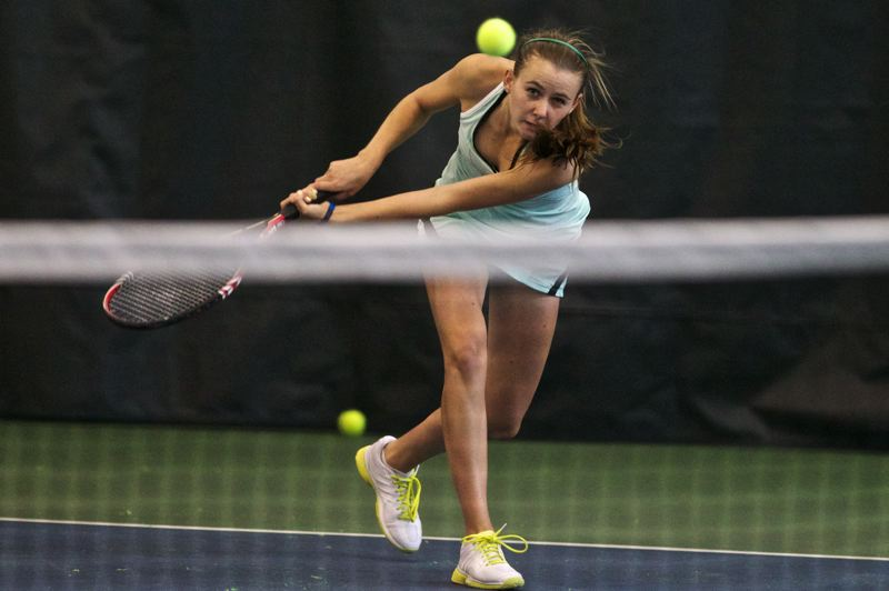 by: TIMES PHOTO: JAIME VALDEZ - Jesuit junior Erin Larner returns a volley against teammate freshman Bess Waldram in the 6A girls tennis championship at Tualatin Hills Tennis Center.