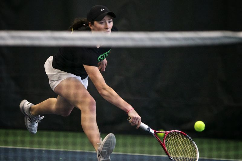 by: TIMES PHOTO: JAIME VALDEZ - Jesuit freshman Bess Waldram reaches reaches for the ball against teammate junior Erin Larner in the 6A girls tennis championship at Tualatin Hills Tennis Center.