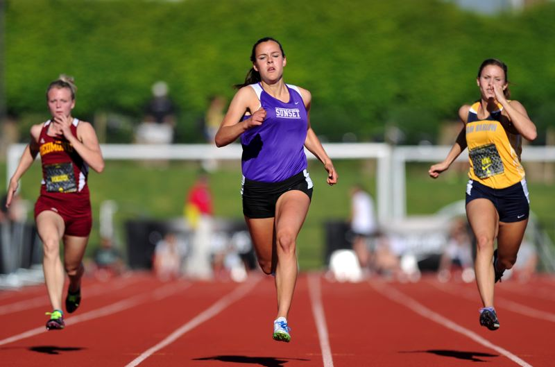 by: COURTESY PHOTO: JEFFREY LIM - Southridges Jordyn Searle and Sunsets Taylor Coon had a photo finish in the Metro District 100-meter dash on Friday with Coon winning by a nose.