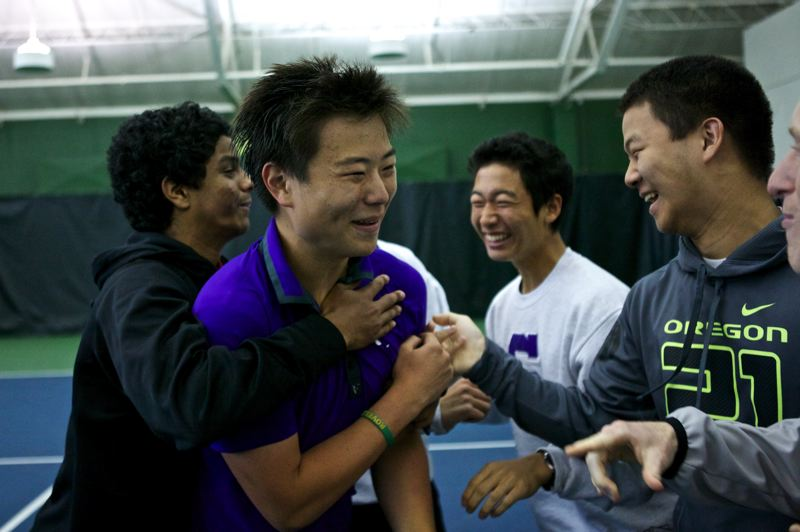 by: TIMES PHOTO: JAIME VALDEZ - Sunsets Ian Paik celebrates with friends after he and his doubles partner, Brian McKittrick, defeated Jesuits Tommy Mulflur and Andrew Newell for the  6A boys doubles tennis championships at the Tualatin Hills Tennis Center.