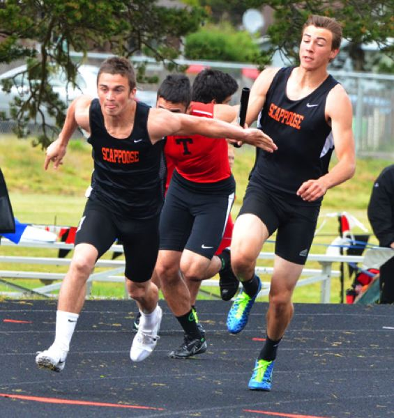 by: JOHN BREWINGTON - Scappoose's Paul Revis takes a handoff from Justice Oman for the last leg of the 4x100 relay at the Cowapa League District meet. The Indians won the event, and it Revis handing off to Oman for the last leg of the 4x400 to win that event. Both Revis and Oman qualified for state in four events.