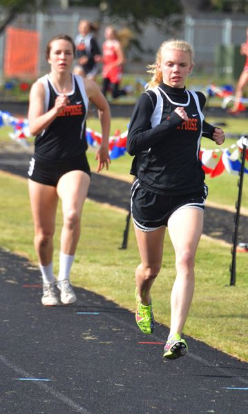 by: JOHN BREWINGTON - Scappoose's Charlie Davidson won the 1,500 and 800 meter runs at district Abby Kessi took second in the 800.