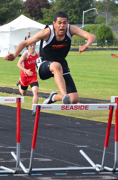 by: JOHN BREWINGTON - Scappoose's Jadyn Harris would probably like to have another shot at the last hurdle on Friday at district, but he still won the race to earn a trip to state. He was also on the winning 4x100 relay team.