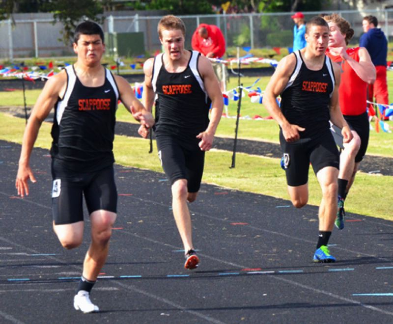 by: JOHN BREWINGTON - Scappoose's Jarrett White (left) won the 200, was second in the 100, and also ran in the short relay. Kyle Nick and Nick Rust were third and fourth in the 200.