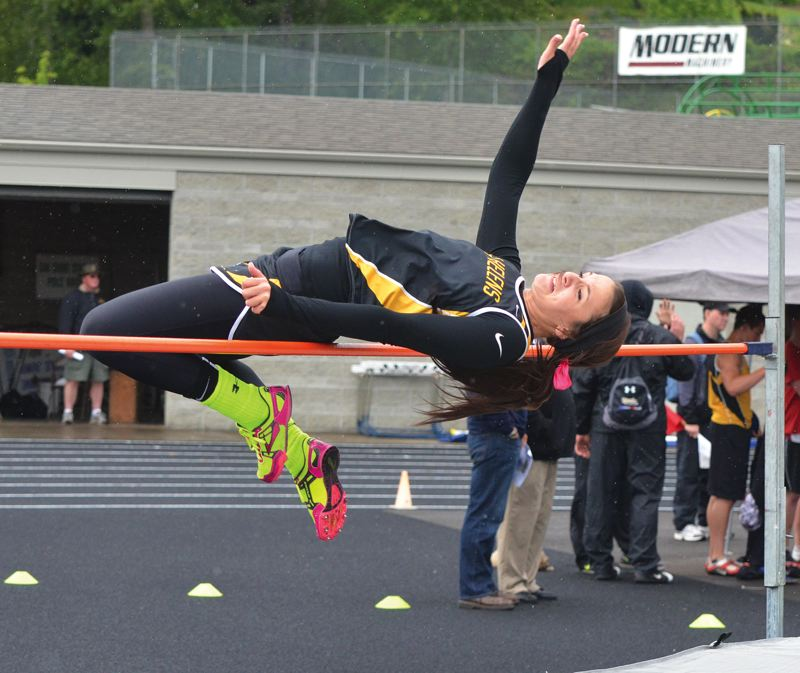 by: JOHN BREWINGTON - St. Helens' Kyle Reinholdt tied for first in the high jump, but missed a trip to state based on the number of jumps. She went on to win the long jump and take second in the triple jump.
