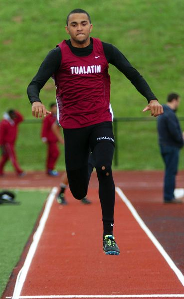by: DAN BROOD - BEAU KNOWS -- Tualatin High School senior Beau Kennedy soared to victory in the triple jump at the Pacific Conference district meet.