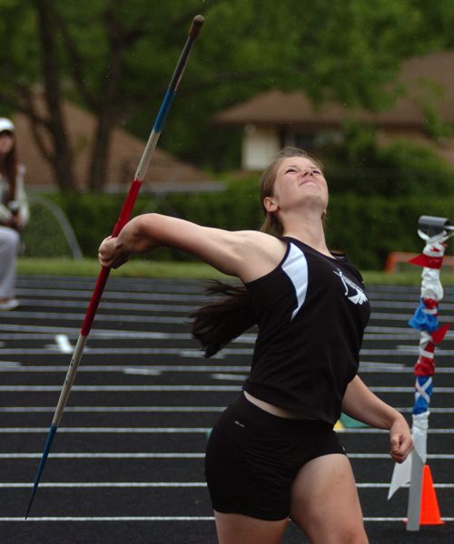 by: DAN BROOD - LET IT FLY -- Sherwood freshman Payge Cuthbertson is getting ready to fling the javelin during competition last Thursday at the NWOC meet.
