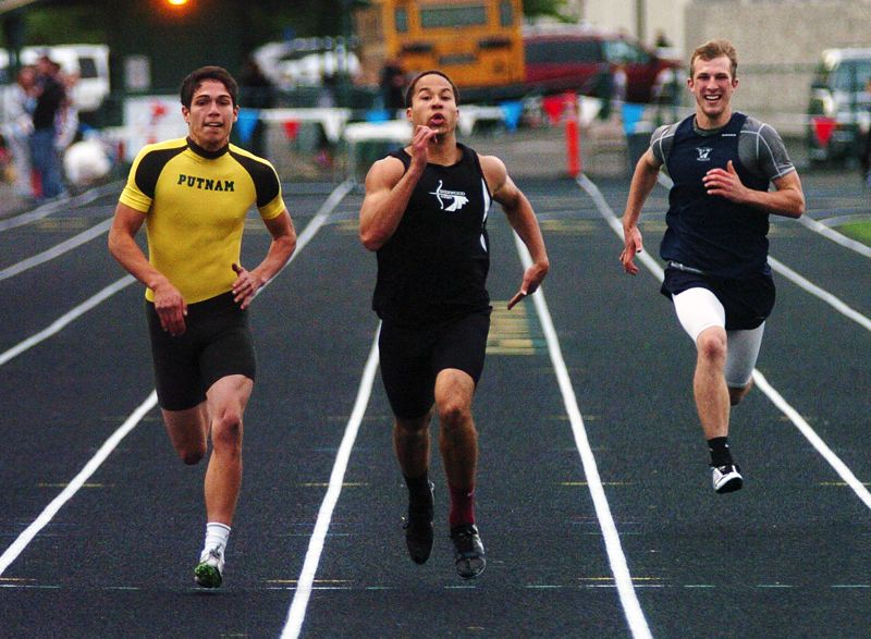 by: DAN BROOD - FINISHING FAST -- Sherwood High School senior Cristian Morris (center) runs to victory in his preliminary heat of the 200-meter dash last Thursday at the Northwest Oregon Conference district track and field meet. Morris qualified for the Class 5A state meet in four events.