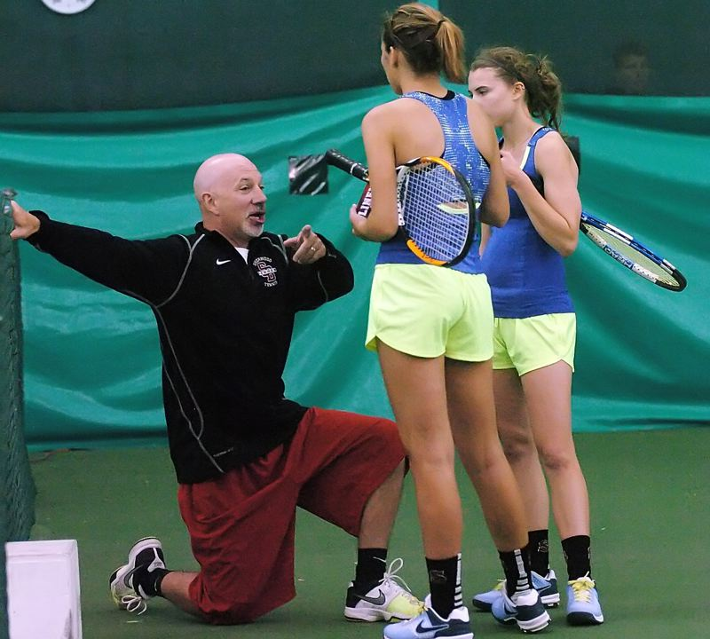 by: DAN BROOD - COACH CHAT -- Sherwood High School girls tennis coach Jim Krauel gives some advice to Lady Bowmen seniors Kelsey Niebergall (right) and Carley Mills during Saturday's consolation doubles title match.