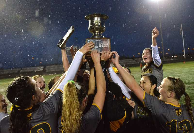 by: VERN UYETAKE - The team celebrates its state championship win after beating Lake Oswego.