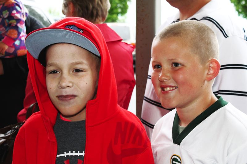 by: OUTLOOK PHOTO: CARI HACHMANN - Joe MacDonald (Left) and friend, Carter Baggs, share a love for football.