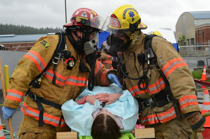 by: PHOTO BY: STAFF SGT. APRIL DAVIS - Firefighters decontaminate and triage victims of a simulated bioterrorism attack at the Armed Forces Reserve Center during the PACE Setter (Portland Area Capabilities Exercise) at Camp Withycombe in Clackamas on March 22. The purpose of the exercise was to test regional and interagency response to public health incidents affecting multiple agencies.