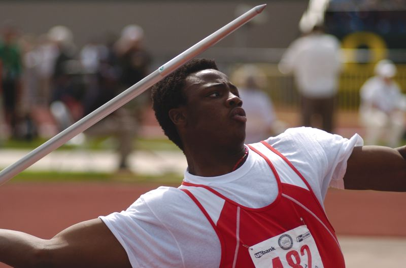 by: THE OUTLOOK: DAVID BALL - David Douglas senior Samson Ebukam lets loose with a throw in the javelin. He led the event for three rounds before settling for second place.
