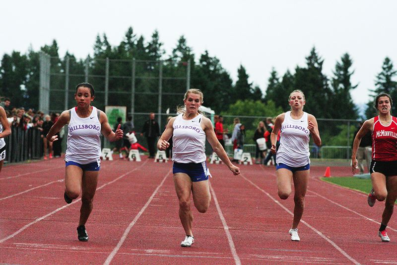 by: HILLSBORO TRIBUNE PHOTO: AMANDA MILES - Hillsboro sprinters (from left) Krissy Thomas, Anna Dean and Cassidy Estep race to a sweep of the top three spots in the 100 meters at last week's Pacific Conference district meet.