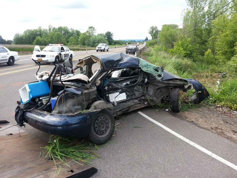 by: WASHINGTON COUNTY SHERIFF'S OFFICE. - Witnesses say the driver of this 1997 Saturn ran a stop sign into the path of a pickup truck, whose driver couldn't stop before hitting its passenger side.